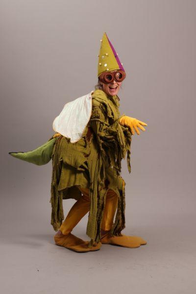Artistiasu vuokrapuku, dinosaurusolio pikahahmo / penkkarit